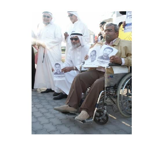 AbdulJalil Alsingace (r) protesting against arbitrary detention