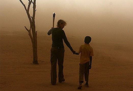 Mia Farrow with Darfurian refugee at Olympic Dream for Darfur torch relay commencement