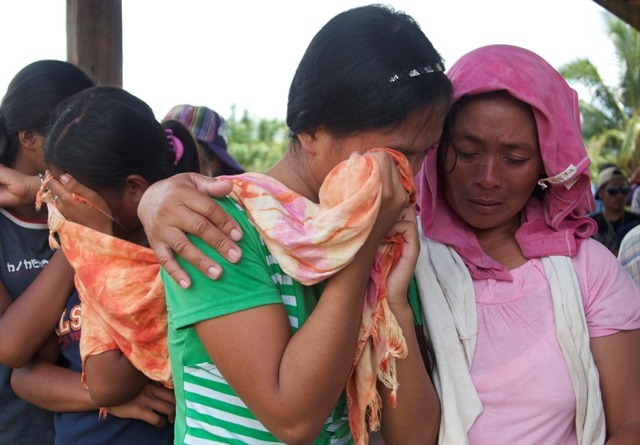 Women in Mindanao crying over their murdered relatives