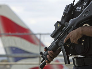 british_police_holding_gun